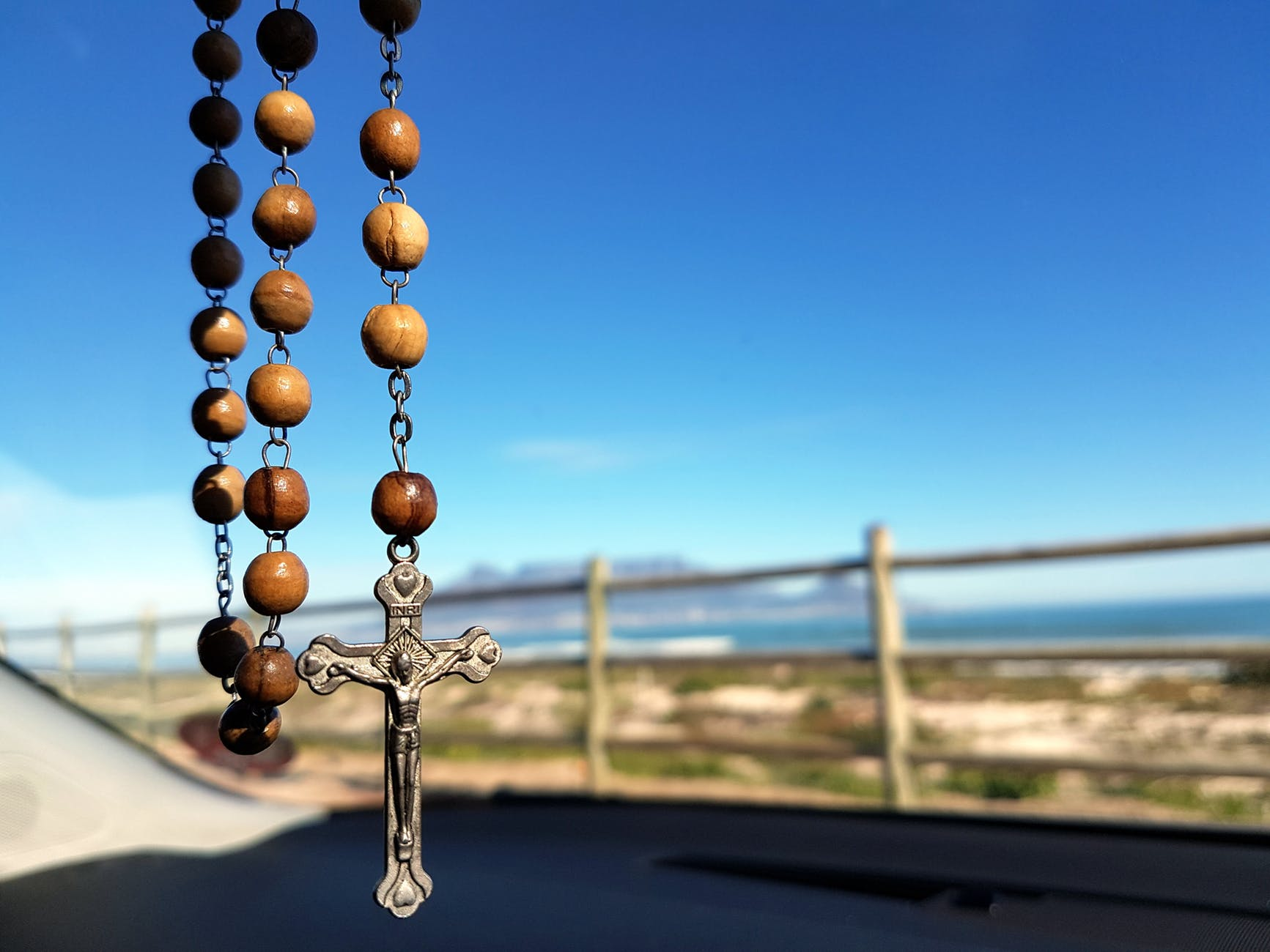 selective focus photo of brown and silver rosary